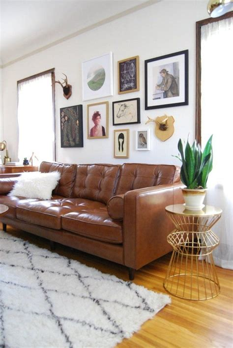 pictures over sofa 17 best ideas about brown leather couches on pinterest