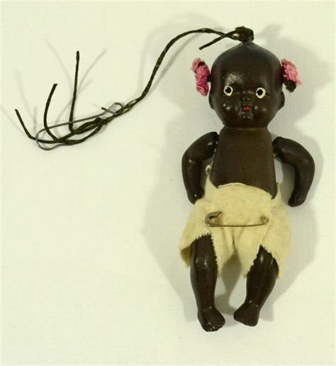 black doll made in vintage black string jointed bisque baby doll made in
