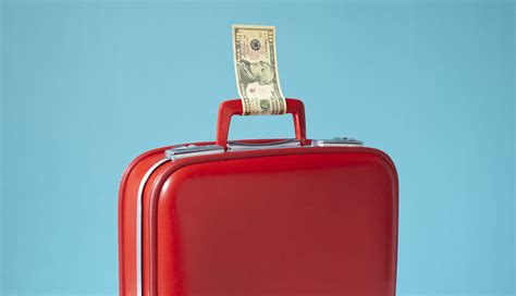red suitcase  money tied  handle   save  airfare