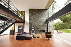 double height ceiling with glass wall white painting and