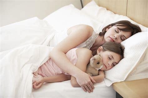 in bed with mom why you shouldn t care if i cosleep with my baby or kid