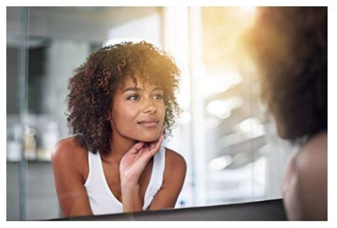 black woman looking in mirror if your natural hair could talk what would the