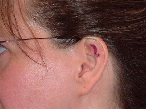small ear tattoo awesome ear designs for and