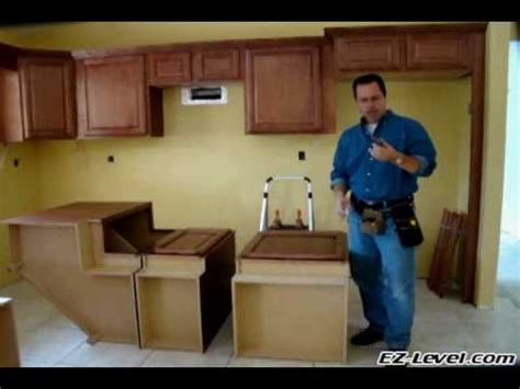 how to fit kitchen cabinets how to install base cabinets part 1 of 4 wmv youtube