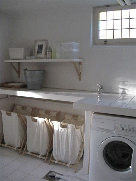 laundry room baskets trio of hers in white laundry room
