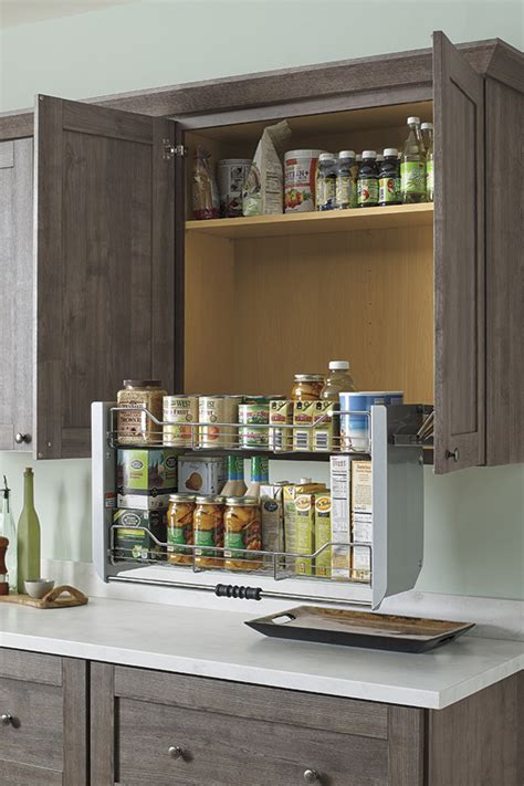Pull down cabinet shelf kemper cabinetry