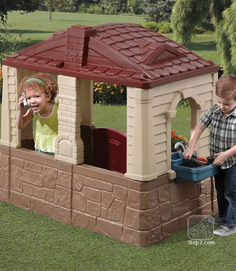neat n tidy cottage outdoor playhouses toys r us house
