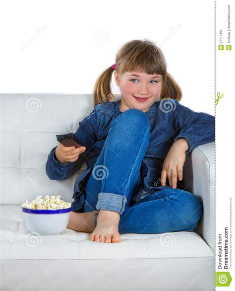 girl sitting on couch girl sitting on a couch watching tv stock image image