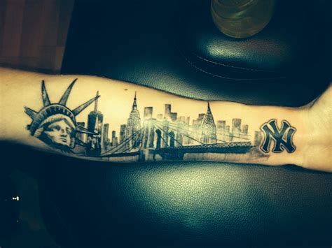 tattoo in new york nyc skyline on my arm statue of liberty one world