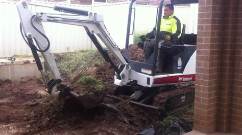 backyard excavation absolute mini digger services retaining wall excavation
