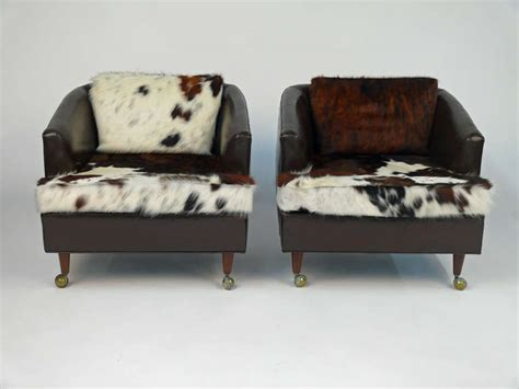 Cowhide Upholstery Leather - pair of leather club chairs castored with new cowhide