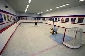 basement rink dull canadian house stocked with rink and zamboni