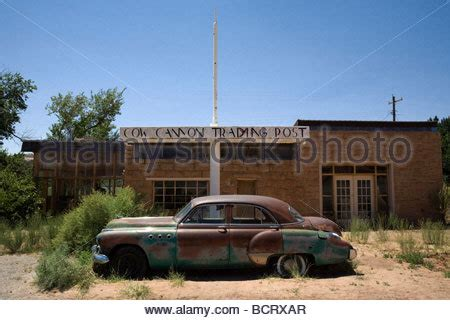 Abandoned Car In Front Of House by Classic American Car With Water Reflection And House In Stock Photo Royalty Free Image