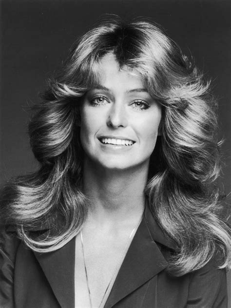 hairstylist giving a customer the 1970 s feathered look remembering the late farrah fawcett on her birthday