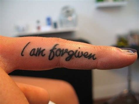 finger tattoo fade quot i am forgiven quot inner finger tat but my
