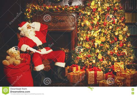 photo of santa claus and christmas tree santa claus around tree stock photo image 79230145