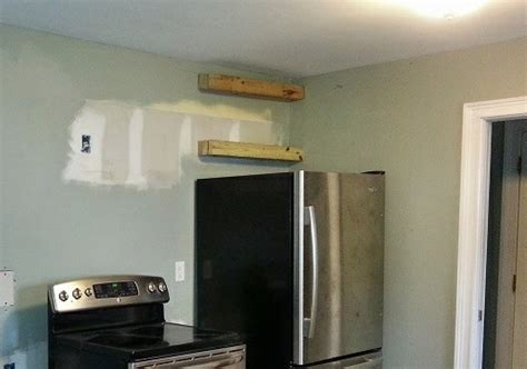 Buy And Build Kitchen Cabinets the air up there maximizing space above the refrigerator