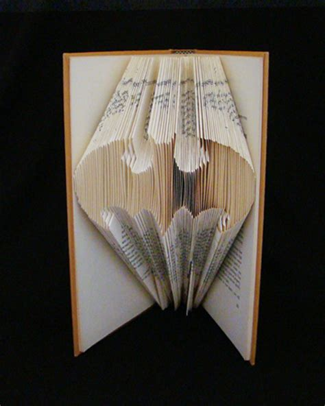 book sculptures make origami