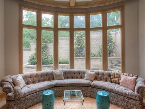 sofa in front of bay window lock her leave her love her when you are home elegant