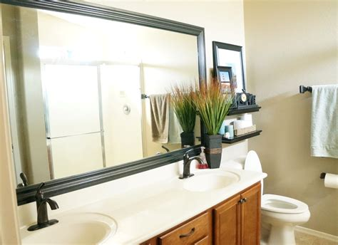 how to add a frame to a bathroom mirror how to frame a mirror the builder s installed a mom s take