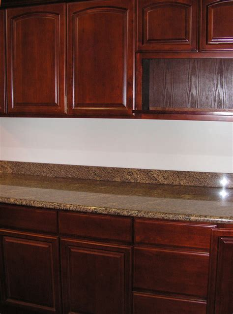 White Wood Stain Kitchen Cabinets Brown Color Staining Oak Kitchen Cabinets With Marble Countertop Ideas And White Wall