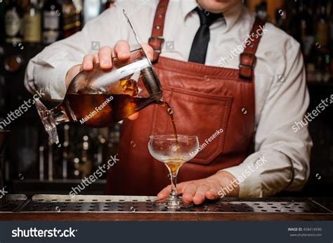 bartender photography bartender pouring fresh cocktail fancy glass stock photo