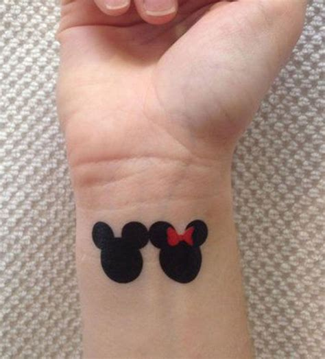 minimalist tattoo with mickey mouse and minnie mouse