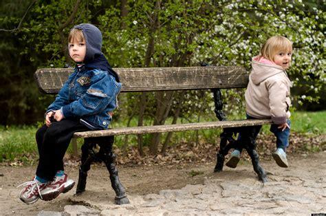 kid on bench sibling bullying as detrimental as peer bullying study claims