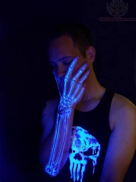 black light tattoos skeleton arm black light