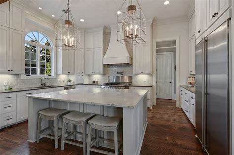 Amazing Islands For Kitchens With Stools #5: White-kitchen-with-marble-counters-large-dining-island.jpg