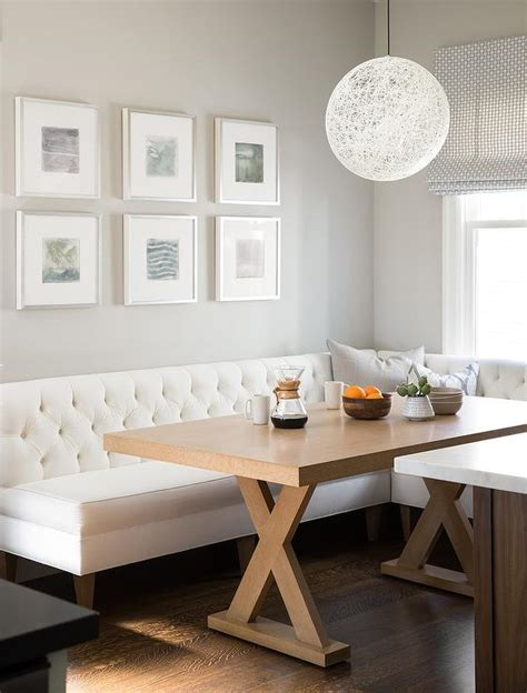 tufted dining banquette honey stained x base dining table with white tufted dining banquette transitional