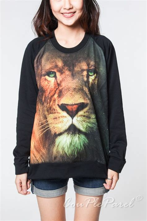 film with a black lion lion sweater aslan narnia animal movie black t shirt women
