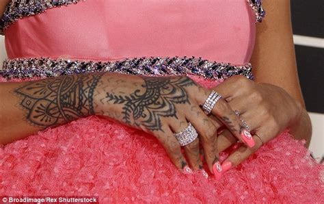 rihanna debuts new flash tattoo line of glamorous