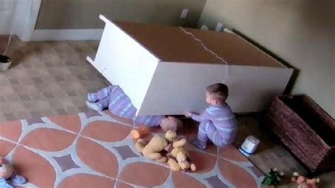 baby falls off bed caught on camera dresser falls on twin boys one toddler