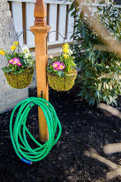 diy garden hose storage  plant hangers hgtv