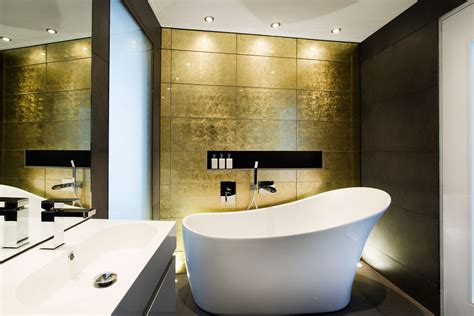 gold bathroom walls gold wall bathroom bath sink mirror modern home in hshire england