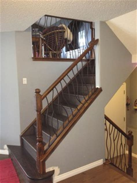 bent iron design interior railing   distressed wood handrail  base rustic staircase