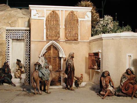 scene  front   inn  creche  angela tripi native art christmas nativity painting