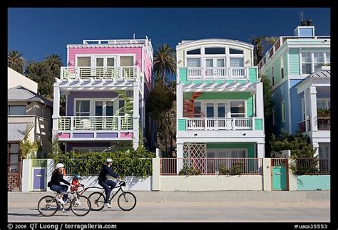 buy house santa monica picture photo family cycling in front of colorful beach houses santa monica los