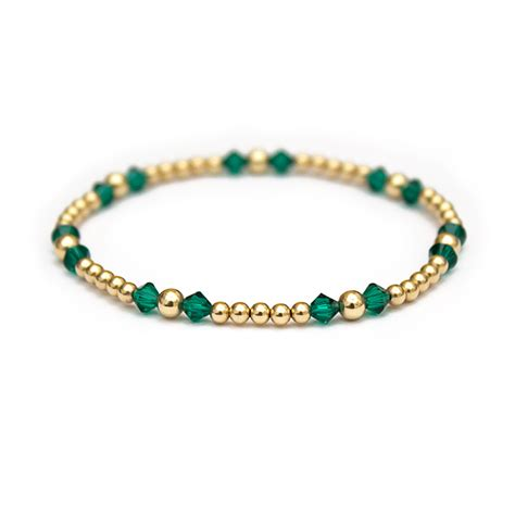 emerald swarovski crystals and 14 ct gold beaded bracelet