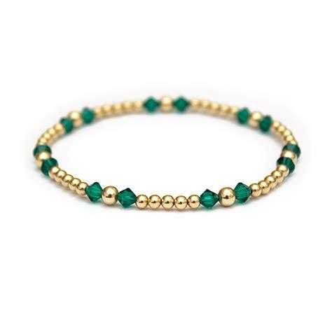 gold beaded bracelet emerald swarovski crystals and 14 ct gold beaded bracelet