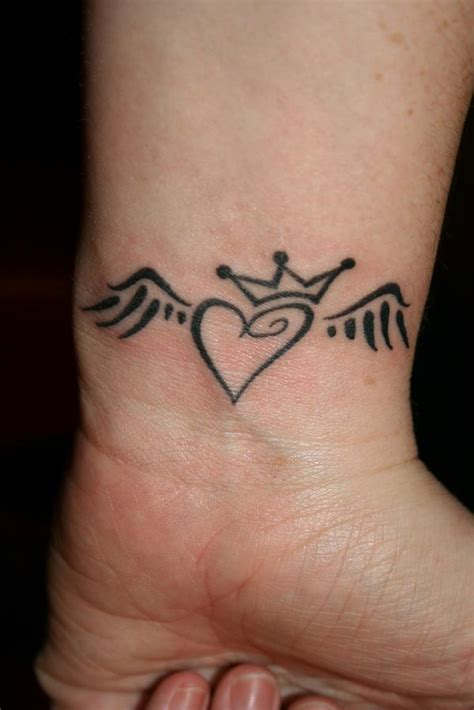 heart with wings tattoo on wrist winged with crown on wrist 187 ideas