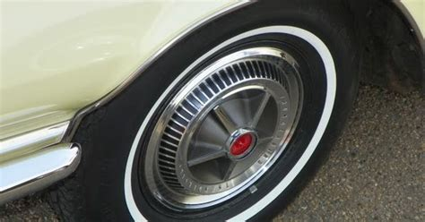 Decor Mural Metal 1962 by 1962 Thunderbird Hardtop Hubcap On A General White Wall