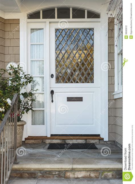 White Front Doors For Homes White Front Door Of Upscale Beige Home Stock Photography