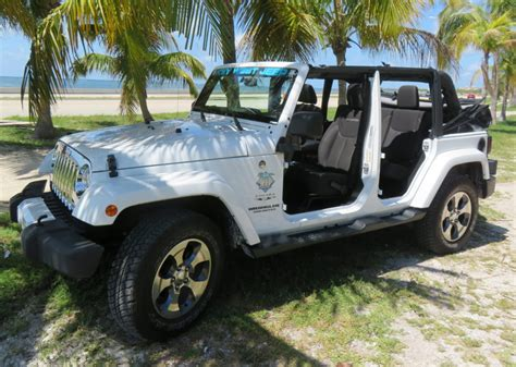 white jeep 4 door jeep models available to rent in key