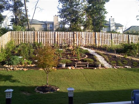 backyard retaining wall should we install a retaining wall in our backyard engineered foundation pools