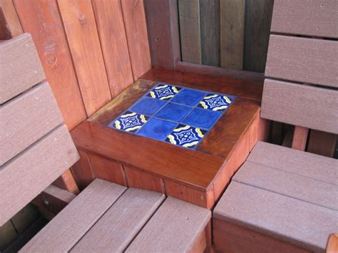 mex crafts imports mexican tile in a table top corner on a deck outdoors