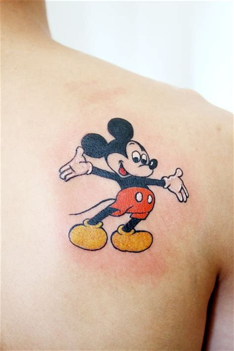 mickey mouse tribal tattoo shoulder mickey mouse by gz