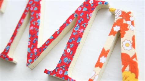 fabric covered wooden letters how to make pretty fabric covered wooden letters diy