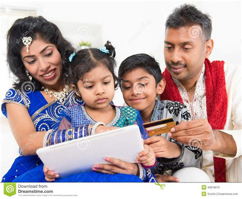 indian asian family shopping with credit ca stock